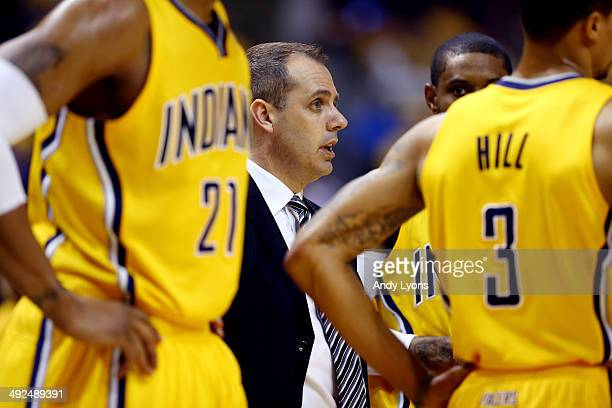 Frank Vogel of the Indiana Pacers speaks to his team during a timeout against the Miami Heat during Game Two of the Eastern Conference Finals of the...