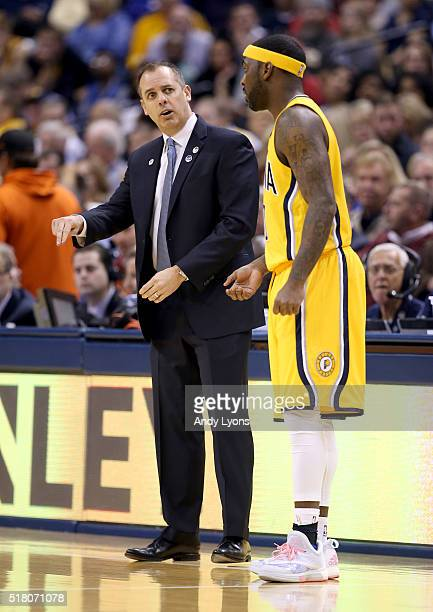 Frank Vogel the head coach of the Indiana Pacers gives instructions to Ty Lawson during the game against the Chicago Bulls at Bankers Life Fieldhouse...