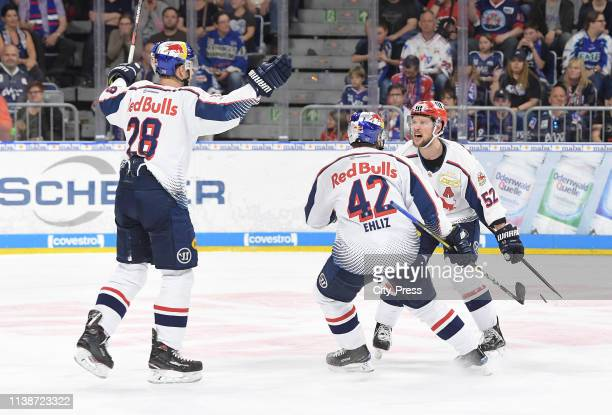 Frank wall, Yasin Ehliz and Patrick Hager of EHC Red Bull Muenchen celebrate after scoring the 3:1 during the DEL finals between the Adler Mannheim...