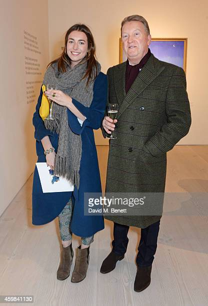 Frank Warren and daughter attend a private view of 'And The Stars Shine Down' by Stasha Palos at the Saatchi Gallery on December 2 2014 in London...