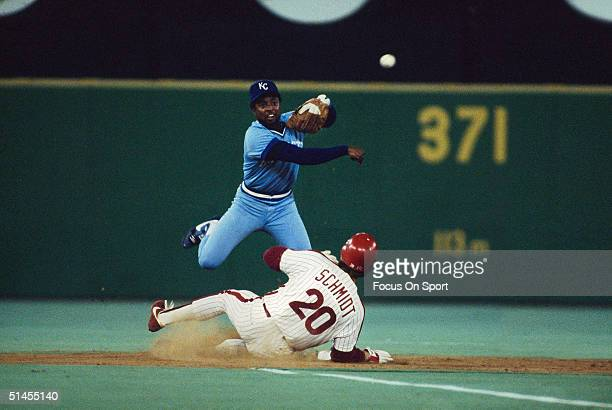 Frank White of the Kansas City Royals throws to first after forcing out Mike Schmidt of the Philadelphia Phillies during the World Series at Veterans...