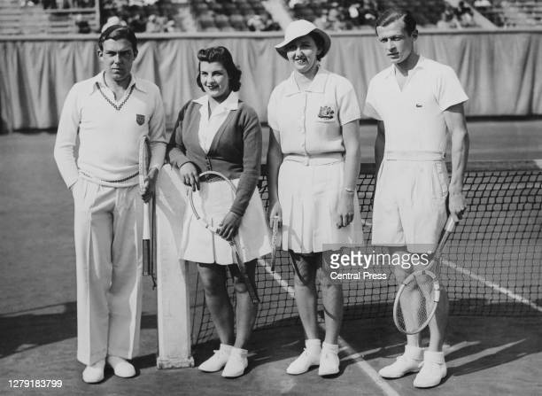 Frank Wilde and Mary Whitmarsh of Great Britain, Nancye Wynne Bolton of Australia and Christian Boussus of France pose for a photograph before their...