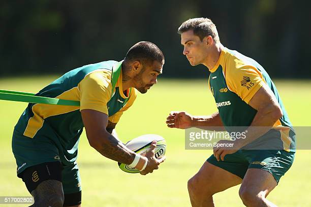 Frank Winterstein is tackled by captain Ed Jenkins during an Australian Sevens training session at the Sydney Academy of Sport on March 23 2016 in...