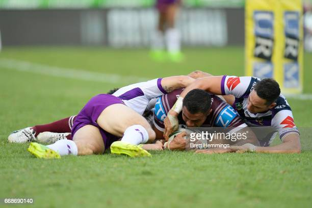 Frank Winterstein of Manly scores a try during the round seven NRL match between the Manly Sea Eagles and the Melbourne Storm at Lottoland on April...