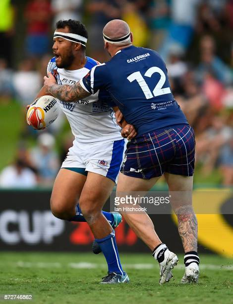 Frank Winterstein of Samoa is tackled by Dale Ferguson of Scotland during the 2017 Rugby League World Cup match between Samoa and Scotland at Barlow...