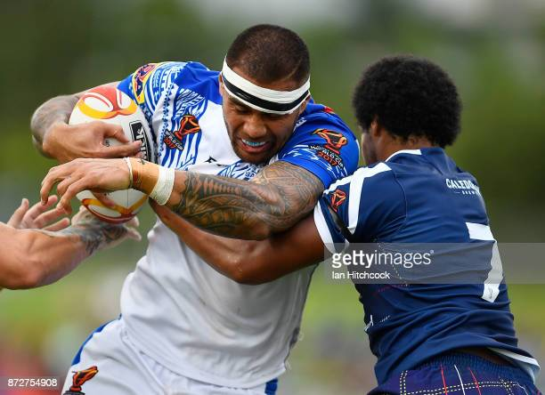 Frank Winterstein of Samoa is tackled by Oscar Thomas of Scotland during the 2017 Rugby League World Cup match between Samoa and Scotland at Barlow...