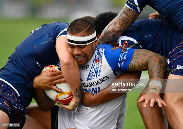 Frank Winterstein of Samoa is wrapped up by the Scottish defence during the 2017 Rugby League World Cup match between Samoa and Scotland at Barlow...