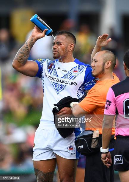 Frank Winterstein of Samoa recieves attention after being injured during the 2017 Rugby League World Cup match between Samoa and Scotland at Barlow...