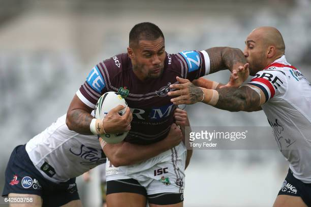 Frank Winterstein of the Sea Eagles is tackled by Blake Ferguson of the Roosters during the NRL Trial match between the Manly Warringah Sea Eagles...