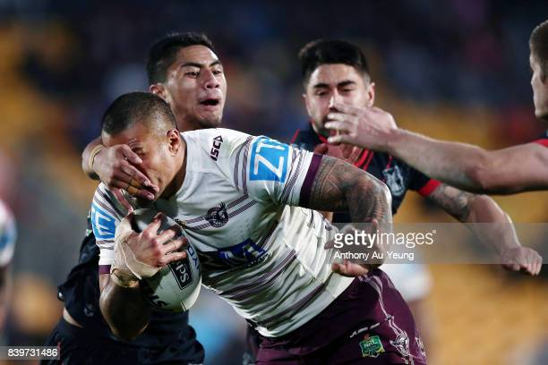 Frank Winterstein of the Sea Eagles is tackled by Mafoa'aeata Hingano of the Warriors during the round 25 NRL match between the New Zealand Warriors...