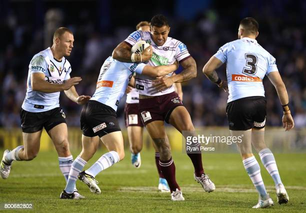 Frank Winterstein of the Sea Eagles is tackled during the round 16 NRL match between the Cronulla Sharks and the Manly Sea Eagles at Southern Cross...