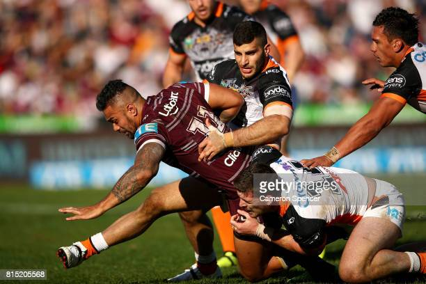 Frank Winterstein of the Sea Eagles is tackled during the round 19 NRL match between the Manly Sea Eagles and the Wests Tigers at Lottoland on July...