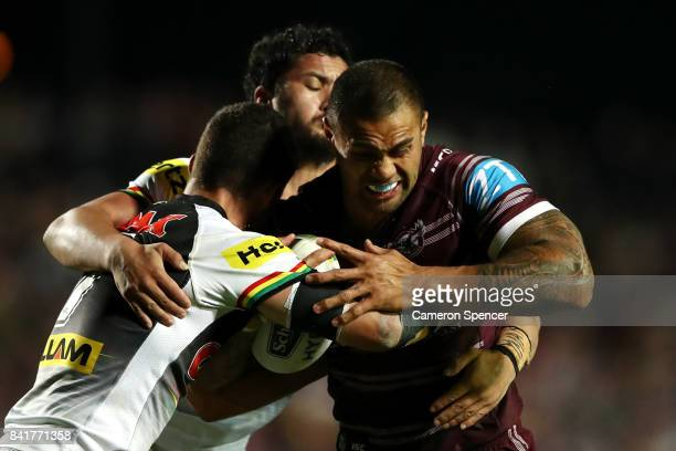 Frank Winterstein of the Sea Eagles is tackled during the round 26 NRL match between the Manly Sea Eagles and the Penrith Panthers at Lottoland on...