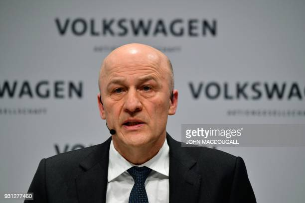 Frank Witter CFO of German car maker Volkswagen speaks during his company's annual press conference in Berlin on March 13 2018 Volkswagen holds its...