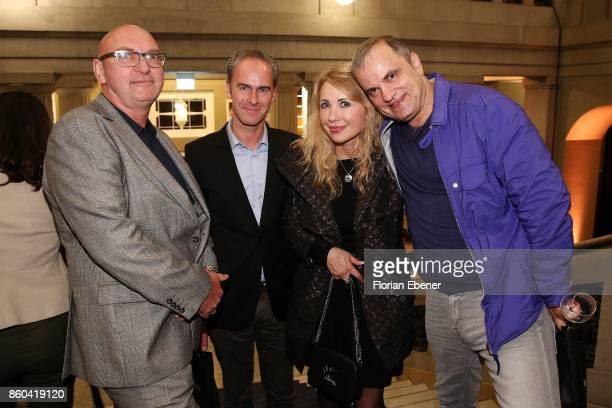 Frank Witthoeft Markus Reiffenschneider Julia Koltler and Alexander Koltler attend the Housewarming Party at Andreas Quartier GmbH on October 11 2017...