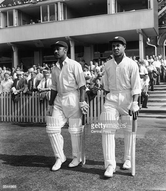 Frank Worrell, left, and Garfield Sobers coming out to bat during the Third England vs West Indies Test at Trent Bridge, Nottingham, July 1957.