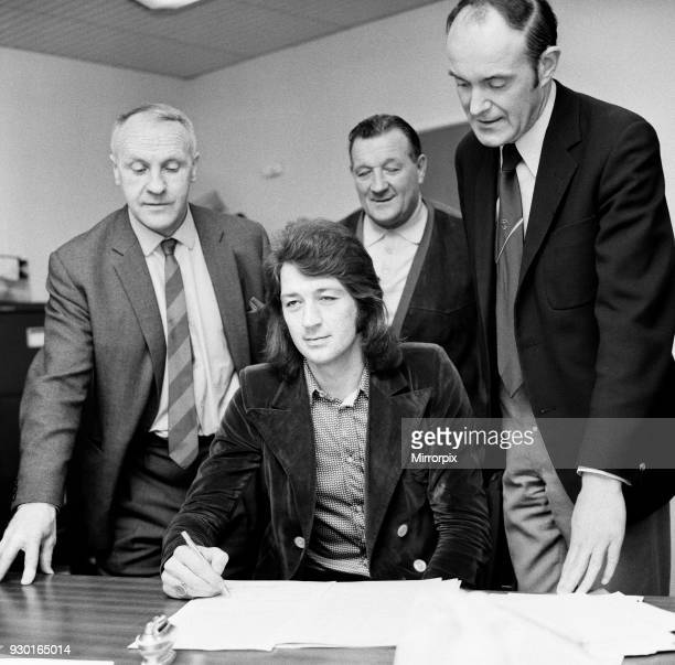 Frank Worthington signs for Liverpool from Huddersfield Town at Anfield watched by manager Bill Shankly, assistant manager Bob Paisley and club...