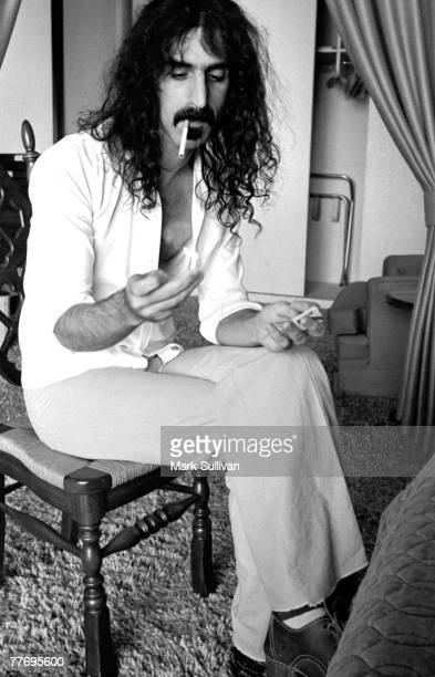 Frank Zappa lighting cigarette in Beverly Hilton Hotel room Beverly Hills CA 1976 Various Locations Mark Sullivan 70's Rock Archive Beverly Hills CA