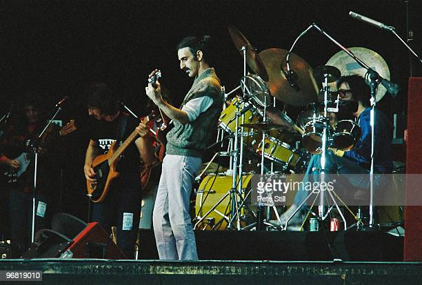 Frank Zappa performs on stage with band members Denny Walley Arthur Barrow Ike Willis and drummer Vinnie Colaiuta at The Knebworth Festival on...