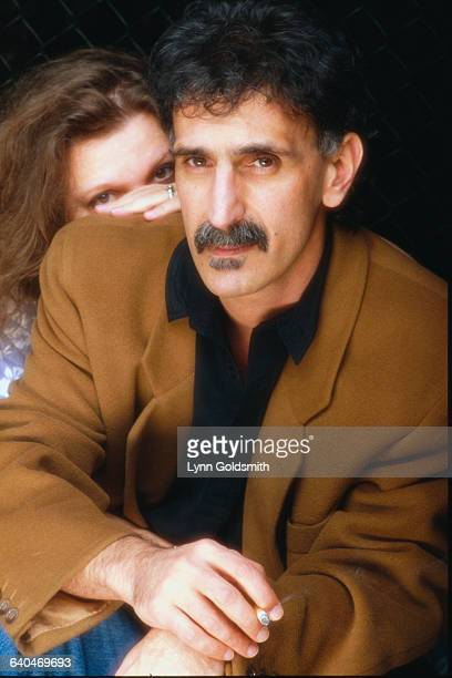 Frank Zappa's wife Gail is hiding behind his shoulder