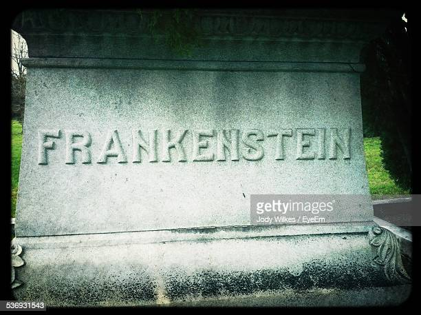 frankenstein written on tombstone in cemetery - frankenstein stock photos and pictures