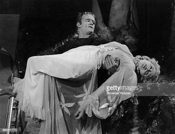 Frankenstein's monster played by Bela Lugosi carries Baroness Elsa Frankenstein played by Ilona Massey in a scene from 'Frankenstein Meets the Wolf...