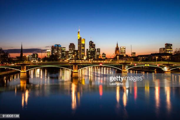 frankfurt am main downtown financial district skyline skyscrapers at night - frankfurt stock pictures, royalty-free photos & images