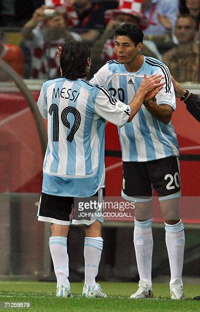 Argentinian forward Julio Ricardo Cruz comes on as a substitute for forward Lionel Messi in the opening round Group C World Cup football match The...