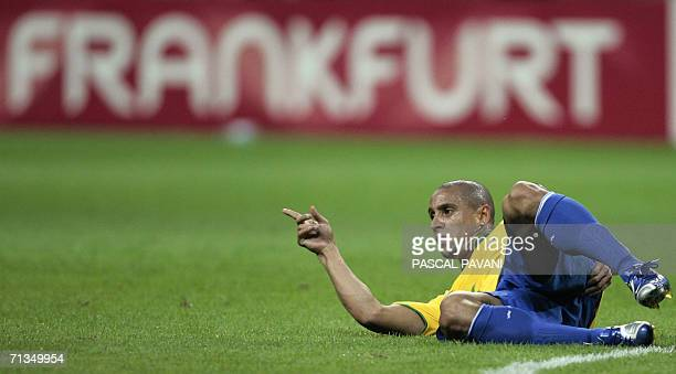 Brazilian defender Roberto Carlos gestures after going down after contact during the quarterfinal World Cup football match between Brazil and France...