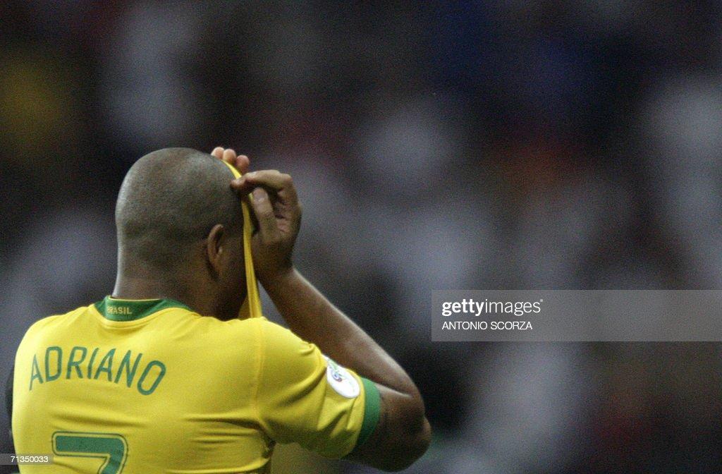 Brazilian forward Adriano covers his fac : News Photo