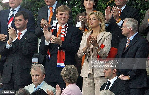 Dutch Crown Prince Willem Alexander and his wife Princess Maxima attend the opening round Group C World Cup football match The Netherlands vs...