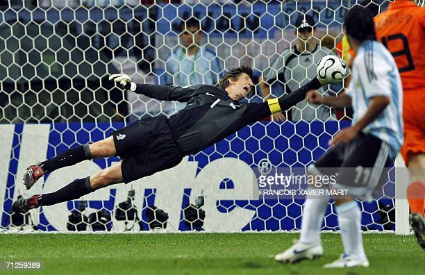 Dutch goalkeeper Edwin Van der Sar dives to stop a ball in the opening round Group C World Cup football match The Netherlands vs Argentina 21 June...