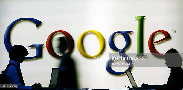 Frankfurt am Main, GERMANY: Fair-goers use laptops at the US search engine giant Google's stand at the Frankfurt Book Fair 08 October 2006. Human...