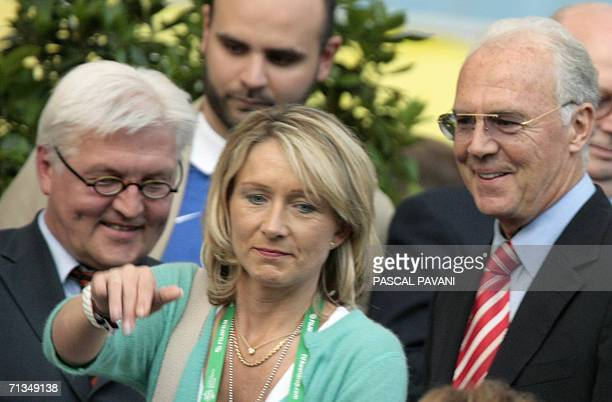Heidrun the wife of World Cup 2006 organising committee chief Franz Beckenbauer gestures as German Foreign Minister Frank Walter Steinmeier looks on...