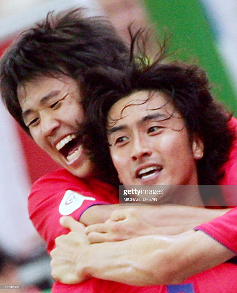 South Korean forward Jung Hwan Ahn (R) jubilates with a teammate after scoring a second goal for his team during the FIFA World Cup 2006 group G football match Korea vs Togo, 13 June 2006 at Frankfurt stadium.
