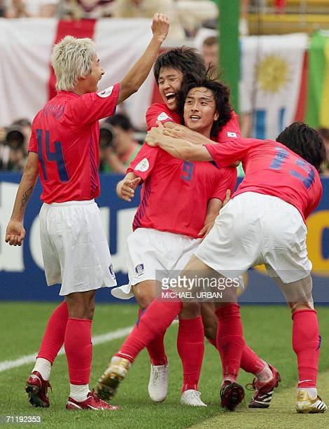 South Korean forward Jung Hwan Ahn jubilates with teammates after scoring a second goal for his team during the FIFA World Cup 2006 group G football...