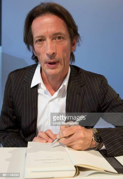 Frankfurt Book Fair 2017 Oskar Roehler German author journalist and film director signed his book