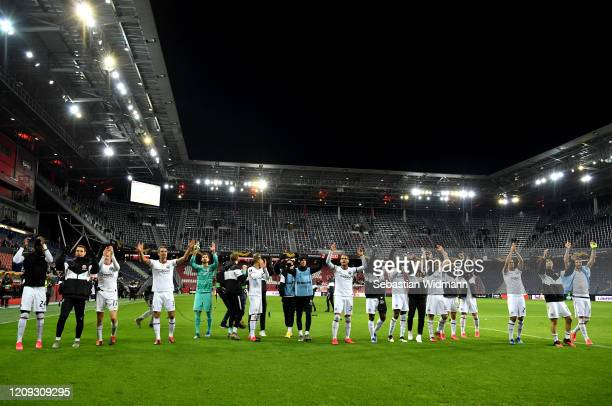 Frankfurt celebrates victory during the UEFA Europa League round of 32 second leg match between RB Salzburg and Eintracht Frankfurt at Red Bull Arena...
