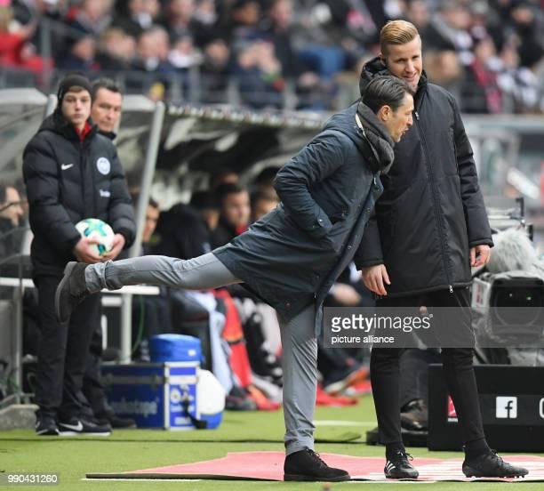 Frankfurt coach Niko Kovac and assistant referee Arne Aarnink in conversation on the sidelines during the German Bundesliga football match between...