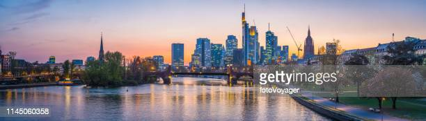 frankfurt financial district skyscrapers glittering river main panorama sunset germany - frankfurt main stock pictures, royalty-free photos & images