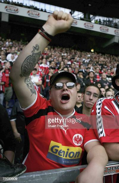 A Frankfurt football fan cheers during the UEFA Cup second leg match between Brondby Copenhagen and Eintracht Frankfurt at the Brondby stadium on...