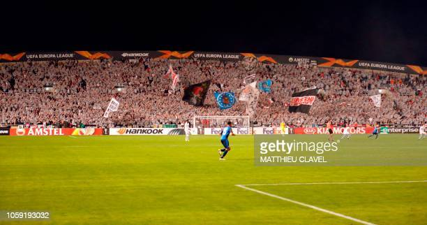 Frankfurt supporters cheer at the start of the Europa League Group H football match between Apollon Limassol and Eintracht Frankfurt on November 8 at...