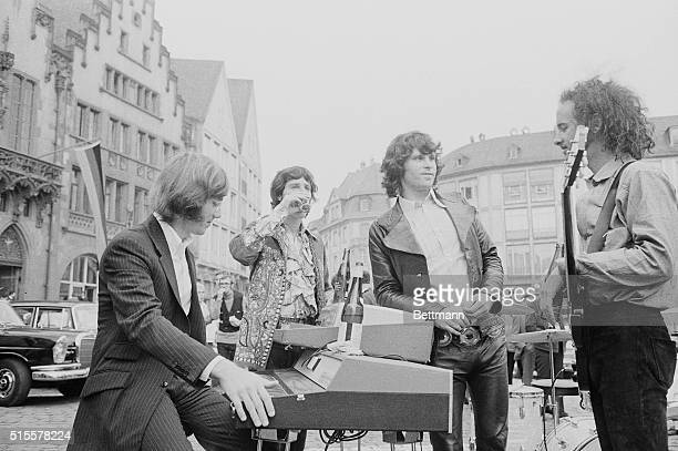 'The Doors' pop group from Los Angeles shown during a break in the openair concert which they were taping in front of town hall The show is for...