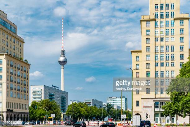 frankfurter allee and berlin tv tower on the background - surrounding stock pictures, royalty-free photos & images