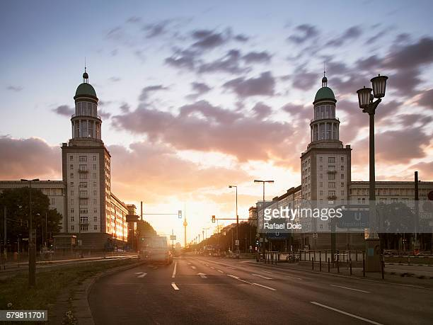 frankfurter tor at sunset, berlin, germany - kreuzberg stock photos and pictures