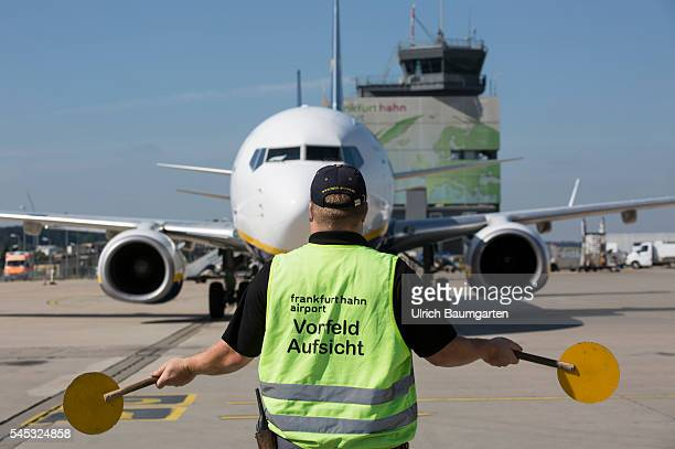 FrankfurtHahn Airport Marshalling an incoming Ryanair passenger jet