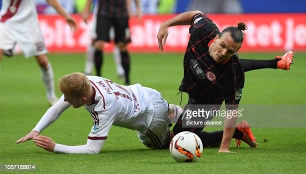 Frankfurt's Alexander Meier and Nuremberg's Sebastian Kerk vie for the ball during the German Bundesliga relegation match in Frankfurt/Main,Germany,...
