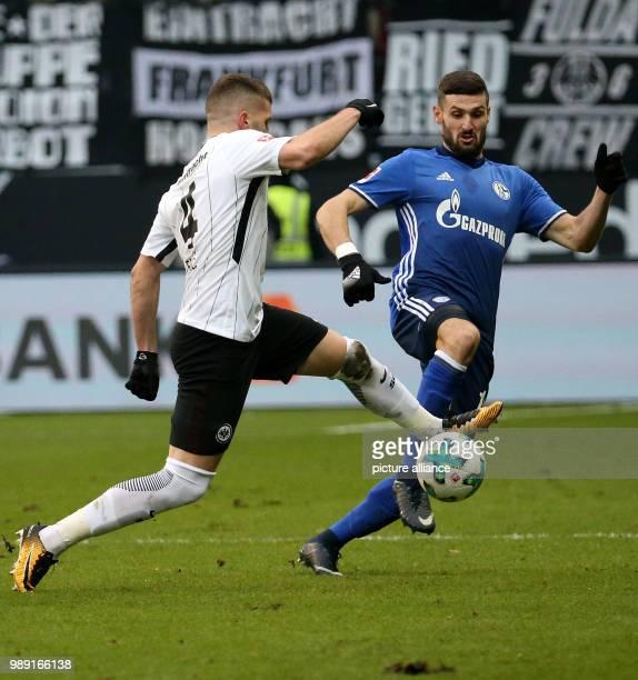 Frankfurt's Ante Rebic and Schalke's Daniel Caligiuri vie for the ball during the German Bundesliga soccer match between Eintracht Frankfurt vs FC...