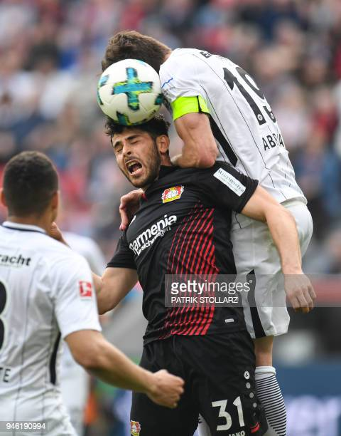 Frankfurt's Argentinian defender David Abraham and Leverkusen's German forward Kevin Volland vie for the ball during the German first division...