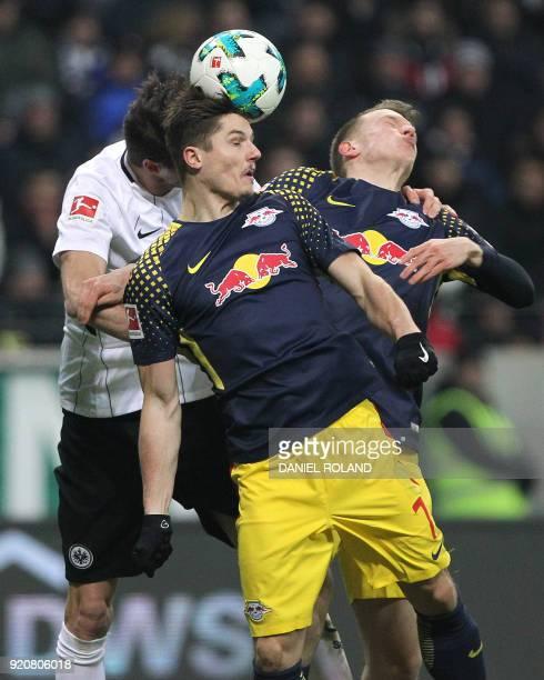 Frankfurt's Argentinian defender David Abraham Leipzig's Austrian midfielder Marcel Sabitzer and Leipzig's German defender Lukas Klostermann vie for...